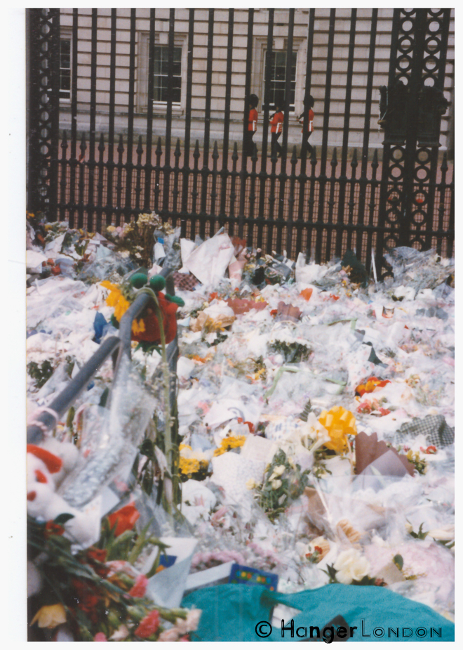 Floral Tributes laid in sympathy for Princess Diana Outside Buckingham Palace. The 3 guards on duty, providing some familiar structural normality to what seemed a slowed down space of uncertainty in time. September 1997