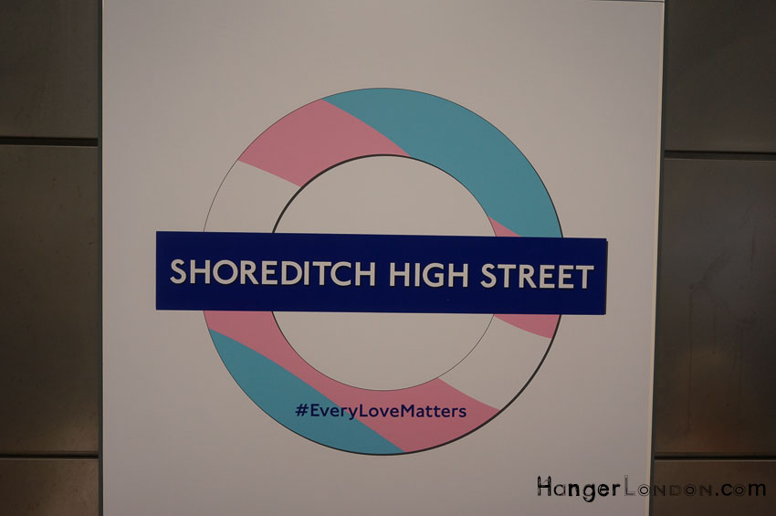 Shoreditch High street TFL rondel in the colours of the Rainbow Flag for Pride London 2018