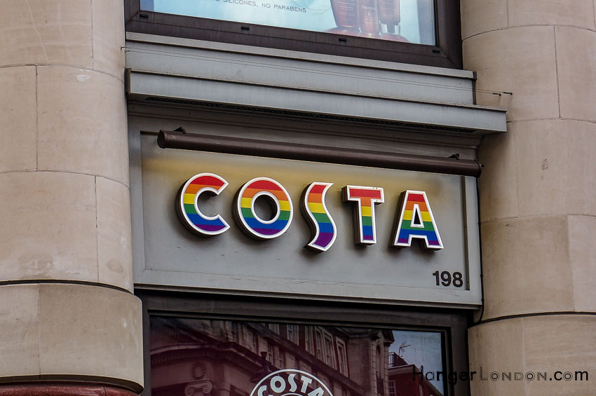 Costa supporting Pride colour flag